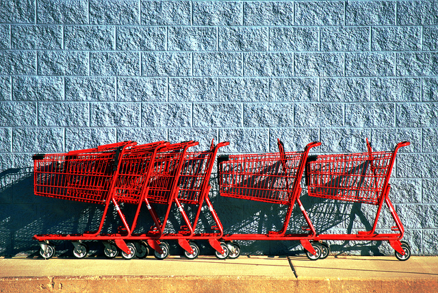 Groovy Green Livin retail red carts, blue wall